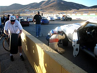 "Willow Springs International Motorsports Park - Turn 3/4/5, or ""The Omega"", can be seen on the hillside above Pit Lane."