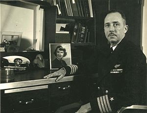 William V. Davis - Captain William V. Davis Jr. in his quarters on board the USS Franklin D. Roosevelt.  Naval Aviator insignia is above campaign ribbons.