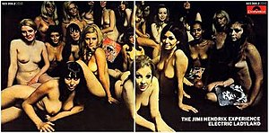 A color photograph of a record sleeve featuring an image of several naked woman