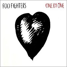 A black heart drawing against a white background On the upper left is Foo Fighters in black letters and on the upper right One by One in red ones