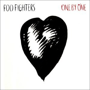 "A black heart drawing against a white background. On the upper left is ""Foo Fighters"" in black letters, and on the upper right, ""One by One"" in red ones."
