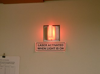 Warning system - Warning light indicating danger of laser exposure