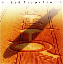 A zeppelin flying across a crop circle