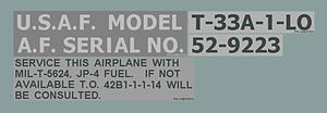 United States Department of Defense aerospace vehicle designation - Typical Vehicle Designation Stencil for a USAF aircraft. This one is on the port side of a T-33A under the canopy frame.