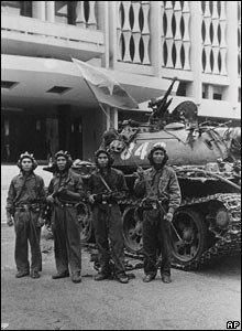 NVA pose for picture in Presidential Palace at end of Vietnam war