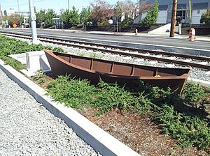 Passage (sculpture) - One of the installation's 38 weathered steel boat sculptures; this one was photographed at the Southeast 17th Avenue and Holgate Boulevard MAX Station in September 2015