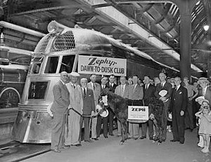 "Chicago, Burlington and Quincy Railroad - The passengers, including ""Zeph"" the burro, that rode the Zephyr on the ""Dawn-to-Dusk Dash"" gather for a group photo in front of the train after arriving in Chicago on May 26, 1934."