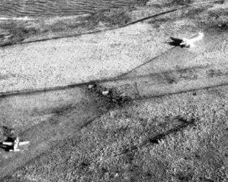 Raid on Pebble Island - Post-raid photo taken from an RAF Harrier showing a T-34 Mentor and a Pucara on the airstrip