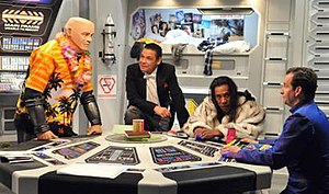 Red Dwarf - From left to right: Kryten, Lister, Cat, and Rimmer as they appeared in 2009's Back to Earth.