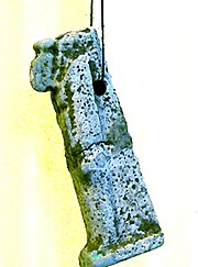 A faience amulet representing Set, often worn by soldiers.
