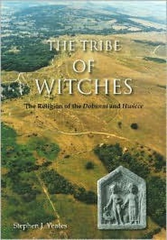 The Tribe of Witches - The first edition cover of the book, depicting Cleeve Hill in the background, with a relief of Mercury and his consort found in Gloucester in the foreground.