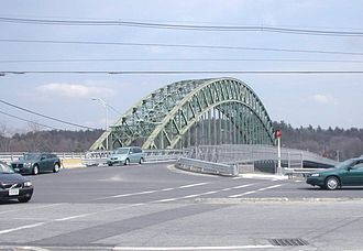 Massachusetts Route 113 - Route 113 crosses the Merrimack River on the Tyngsboro Bridge.  The bridge on the right was a temporary crossing while the 1930s bridge was being rebuilt.
