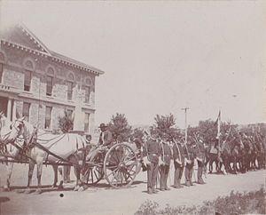 New Mexico State Capitol - U.S. Cavalry at the Santa Fe Territorial Capitol dedication ceremony on June 4, 1900. The 1850 Territorial Courthouse building is at left.