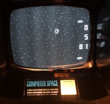 Photograph of gameplay, with white dots on a black screen and instructions below