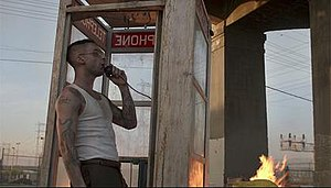 Payphone (song) - A still from the video, where Adam Levine is at a phone booth, making a call from a payphone.