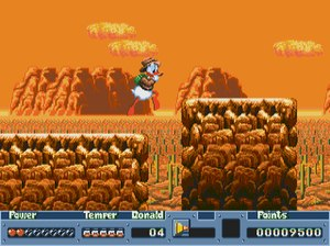 QuackShot - Donald traverses platforms in a level modeled after Mexico. The player's health is signified by the hearts in the lower left corner.