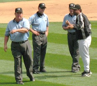 Joe West (umpire) - West (left) ejects Chicago White Sox manager Ozzie Guillén in 2007.