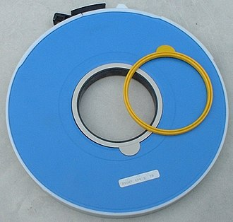 Write protection - IBM tape reel with white write ring in place, and an extra yellow ring.