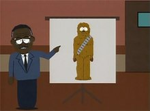 In a scene from the television series South Park, Johnnie Cochran stands in a courtroom, pointing to a picture of Chewbacca on a large screen behind him.
