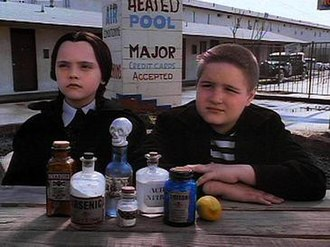Pugsley Addams - Wednesday (left) and Pugsley in The Addams Family film (1991).
