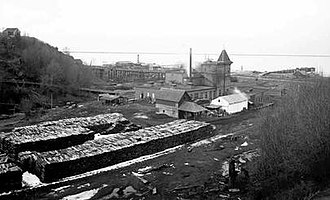 Angeles Brewing and Malting Company - Image of the Angeles brewery, some time between 1901 and 1915.  A large stack of cordwood is near the structure.