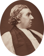 stout, clean-shaven white man in clerical dress