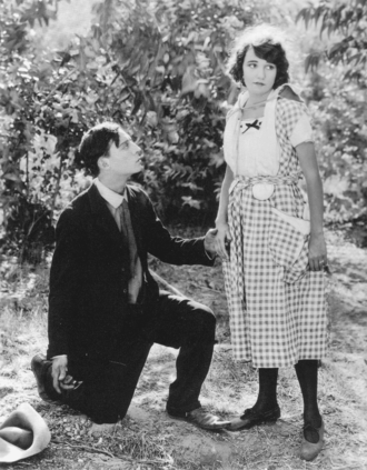 The Scarecrow (1920 film) - Buster accidentally proposes to Sybil in The Scarecrow (1920).
