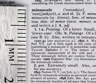Oxford English Dictionary - Part of an entry in the 1991 compact edition, with a centimetre scale showing the very small type sizes used.