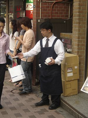 Tissue-pack marketing - A man handing out advertising tissues to passersby in Tokyo