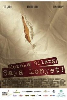 "A poster, showing an elongated tear. The words ""Mereka Bilang, Saya Monyet!"" are stenciled below."