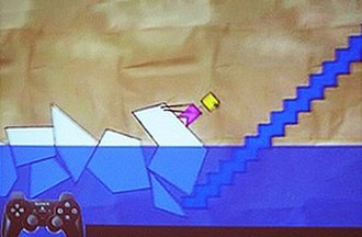 LittleBigPlanet (2008 video game) - A screenshot of the early prototype, Craftworld, depicting Mr. Yellowhead dragging blocks from water.
