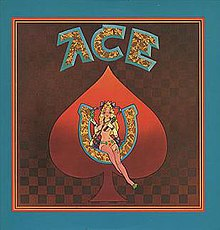 "A painting of a woman seated inside of a horseshoe, superimposed over a red spade from a deck of cards with the word ""ACE"" written above"