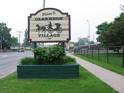 Clarkson Village welcome sign, at Lakeshore Road West and Inverhouse Drive.