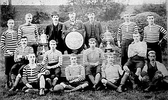 East Stirlingshire F.C. - East Stirlingshire squad in 1891 with several trophies won by the club including the Stirlingshire Cup.