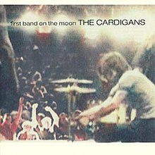 Album cover: a photo of people at a concert with the album and band name superimposed at the top