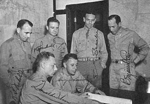 George Kenney - Kenney (center) surrounded by his staff.