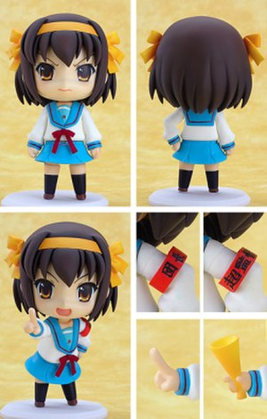 Nendoroid - Nendoroid figure from 2007 depicting the anime character Haruhi Suzumiya. Interchangeable body parts and facial expressions are shown.