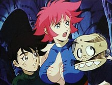 Three animated characters—a short young boy, a tall red-haired girl in a blue, black, and red skin-tight costume, and a short male cyborg—in a dark, cavernous place. The girl has several scratch wounds on her breasts.