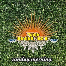 A grass covered background is fronted by a brightly designed No Doubt logo with the title of the song below.