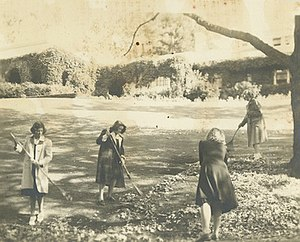 The Branson School - Branson girls raking leaves in front of the Residential Hall in the 1950s