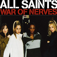 A portrait of All Saints dressed in jackets, standing next to each other in a dark corridor.