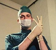 Douglas Adams in his first Monty Python appearance, in full surgeon's garb in episode 42.
