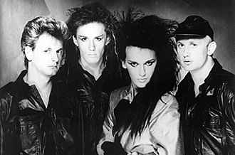 Dead or Alive (band) - Dead or Alive, 1985. From left to right: Mike Percy, Steve Coy, Pete Burns, and Tim Lever.