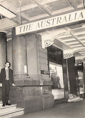 Australia Hotel - A patron stands on the marble steps of the doomed Hotel Australia. The closure notice is pasted on a column.