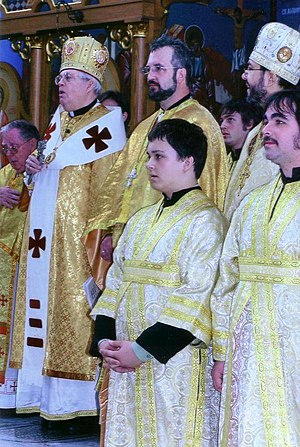 Altar server - Ukrainian Catholic bishop and priests during the Divine Liturgy, with altar servers in front (note the crossed oraria the servers are wearing).