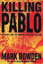 Colombian policemen posing by Pablo Escobar's dead body. Mark Bowden's book cover.
