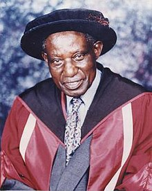A portrait of Wasawo in formal academic attire
