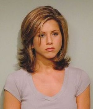 "Rachel Green - Jennifer Aniston portraying her character while donning the famous ""Rachel"" haircut during the second season episode ""The One with Phoebe's Husband"". The hairstyle would go on to become one of the most popular of all time."