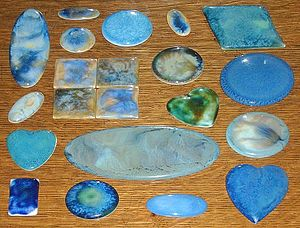 Ruskin Pottery - A selection of the ceramic plaques made by the Ruskin Pottery
