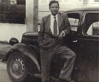 V. S. Naipaul - Seepersad Naipaul, father of V. S. Naipaul, and the inspiration for the protagonist of the novel, Mr Biswas, with his Ford Prefect.